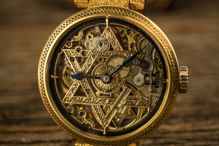Vintage skeleton watch with Star of David on wood background Stok Fotoğraf