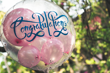 Transparent round balloon inserted with small pink balloons for greeting cerebration Stok Fotoğraf
