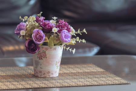 Artificial plants and roses in pot with blurred background Stok Fotoğraf