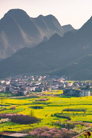 Rapeseed flower field and villages at Wanfenglin National Geological Park (Forest of Ten Thousands Peaks), China