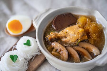 Braised Fish Maw in Red Gravy soup with chicken,  bamboo shoot and Shiitake mushrooms Zdjęcie Seryjne