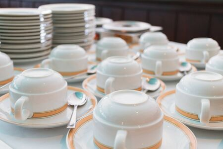 Group of ceramic cup and plates stacked on the table for tea or coffee service Zdjęcie Seryjne