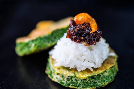 Spicy chili paste with steamed rice and fried Egg with Climbing Wattle on dark background
