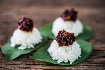 Spicy chili paste with steamed rice on wood background Zdjęcie Seryjne