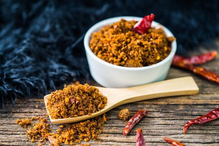 Spicy dried fishes chili paste with wooden spoon and background Zdjęcie Seryjne