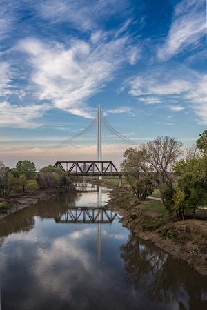 refelction: Margaret Hunt Hill Bridge with refelction on Trinity river daytime, Texas.