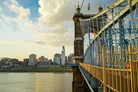John A. Roebling Suspension Bridge with sunset and clouds at Cincinnati, Ohio.