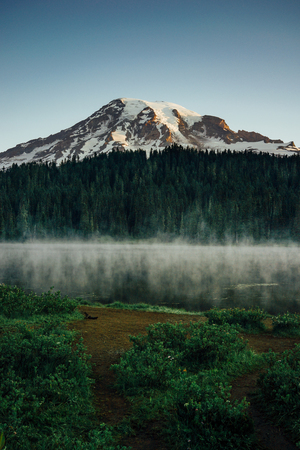 This is the picture of Mt Rainier at Reflection Lakes in the morning with fog and mist at Mt Rainier National Park.