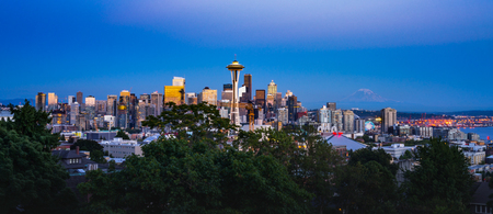 This is the picture of Seattle skyline with Mount Rainier in the background during sunset.