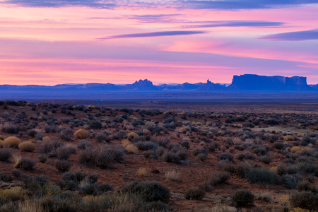 This is the picture of Monument Valley during sunrise, Utah Stock Photo