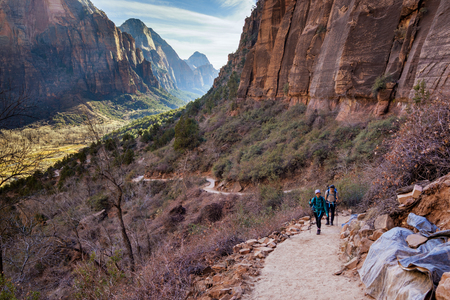 This is the picture of a couple hiking at Zion National Park, Utah.