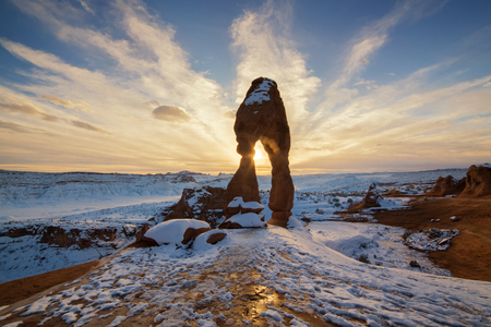 This is the picture of Delicated Arch with snow during sunset at Arches National Park, Utah.