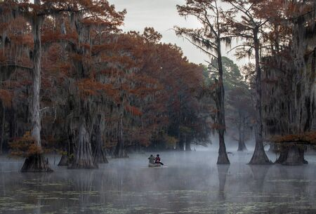 This is a picture of a couple canoing at Caddo Lake, Texas, Louisiana, USA