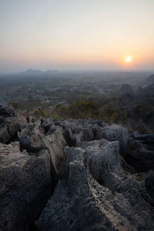 This is the photo of limstone mountain in Pisanulok Thailand during Sunset in rural area, the view is from the top of mountain.