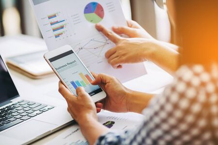 business woman investment consultant analyzing company annual financial report balance sheet statement working with documents graphs. Concept picture of economy, market, office,money and tax.