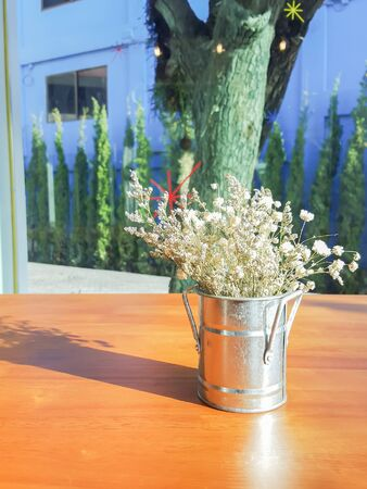 babys: Bouquet of white gypsophila, babys breath flowers, on wooden table Stock Photo
