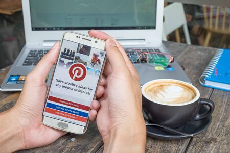 CHIANG MAI,THAILAND - MAR 9,2016 : Man holding a samsung galaxy s6 edge with social Internet service Pinterest on the screen. Pinterest is an online pinboard that allows people to pin their interesting things.