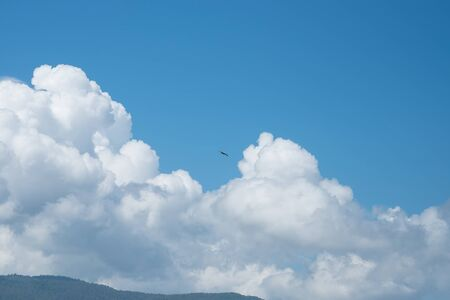 Blue Sky and Puffy Clouds Stock Photo