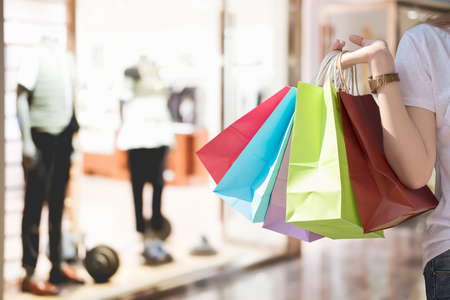 Woman in shopping. Happy woman with shopping bags enjoying in shopping. Consumerism, shopping, lifestyle concept 版權商用圖片