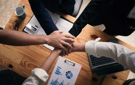 Above view of Teamwork Join Hands Support Together Business Teamwork Concept