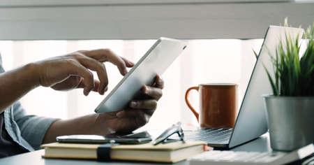 Close up man using smart laptop at home