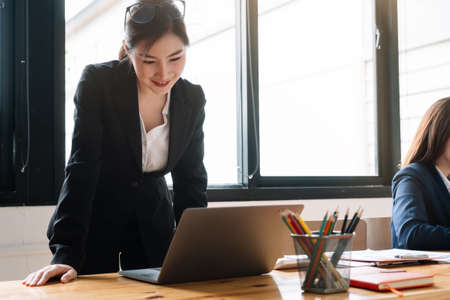 Portrait Of Attractive Asian Businesswoman Working On Laptop for marketing plan Фото со стока