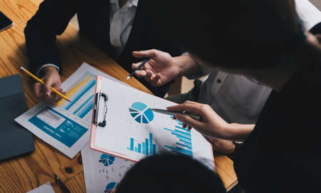 business adviser meeting to analyze and discuss the situation on the financial report in the meeting room.Investment Consultant, Financial advisor and accounting concept