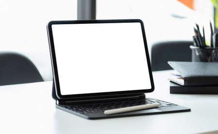 Digital tablet with blank screen on workplace desk Foto de archivo
