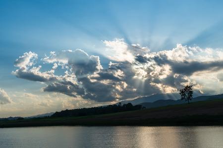 lightbeam: Light beam over mountain landscape Stock Photo