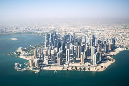 Aerial Wide Shot of Modern Skyscrapers and Apartment Buildings in Downtown Doha (West Bay) on a Sunny Clear Day - Doha, Qatar
