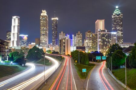 Skyline of Downtown Atlanta and Blurred Highway Traffic at Night - Atlanta, Georgia, USA