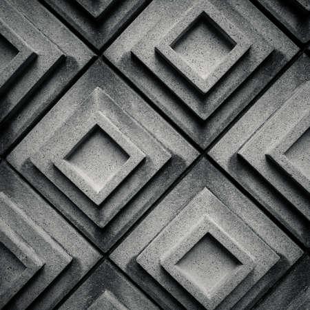 正方形の石のタイルの仕事がクローズ アップ