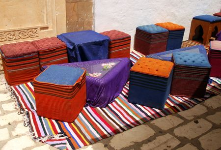 hassock: Cafe in Hammamet Yasmine - seaside city in northern Tunisia. Colorful poufs