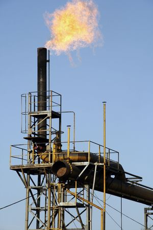 coking: Chimney removing coking gas. Coking plant in Silesia - industrial region of Poland