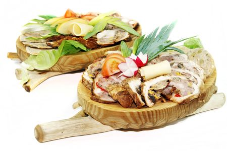 raddish: Roast pork stuffed with minced meat and vegetables, garnished with cheese, raddish and tomatoes
