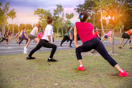 Group of women exercising with aerobics dancing in the garden. lifestyle and healthy concept