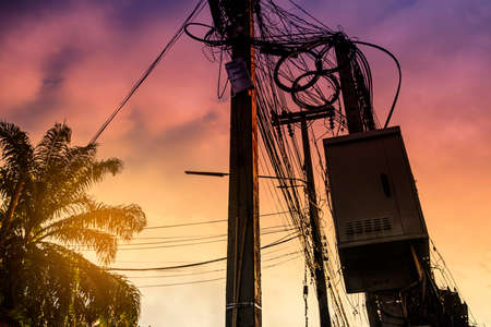 Tangle of Electrical cables and Communication wires on electric pole. Stock fotó