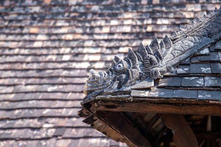 The sculpture on the roof ridge is in Wat Ton keawn , ChiangMai, Thailand.
