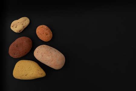Colorful pebbles on black background. Spa, Zen