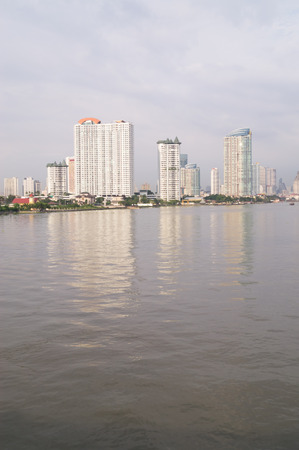 tall buildings: tall buildings near the river in Bangkok of Thailand Stock Photo