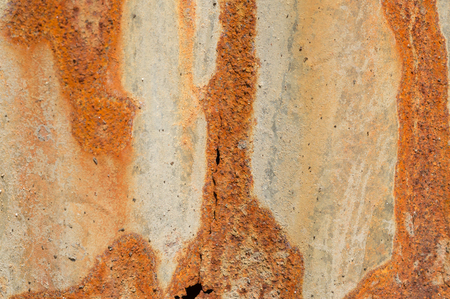 Rust on different colors iron background: Rust on grey, red and blue iron background Stock Photo