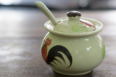 small Chinese ceramic pot with spoon for keeping fish sauce