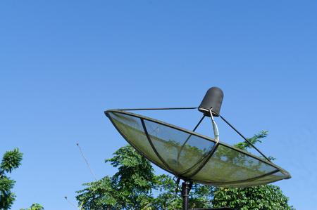 Black satellite dish for telecommunication on  residence roof Zdjęcie Seryjne