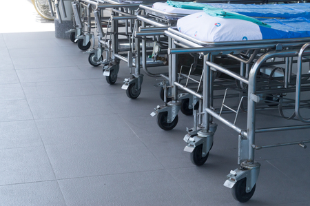 A group of stretchers before a hospital, stretchers in front of a hospital preparing for patients