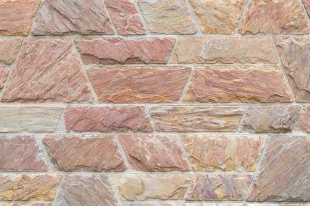 Red beautiful stone wall texture, brown beautiful stone wall texture for interior and outdoor decoration Фото со стока