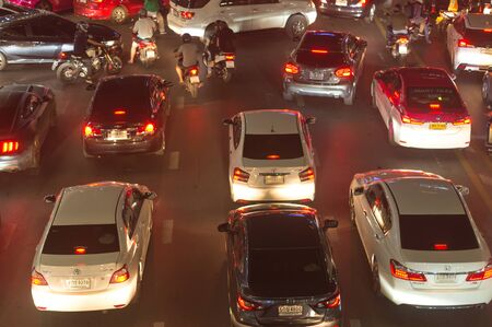Traffic jam causes severe congestion at night in downtown area. Cars get stuck in traffic jam at night in downtown area Stockfoto