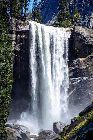 range of motion: I am glad to take amazing shots at the amazing Yosemite National Park. Waterfall is the symbol of Yosemite. Stock Photo