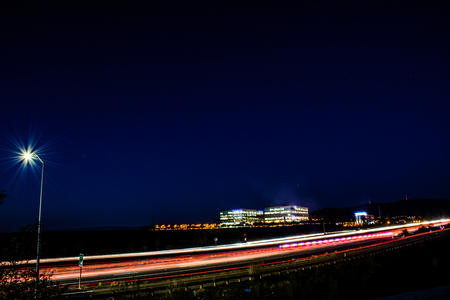 no rush: The busy freeway and office building at Silicon Valley. Long exposure to capture this beautiful night cityscape.
