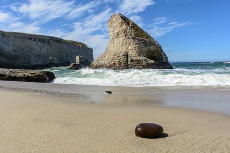 Santa Cruz Shark Fin Cove with Stone on Beach, Under Blue Sky