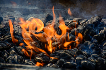 Charcoal fire for BBQ with little smoke in the summer. Stock Photo